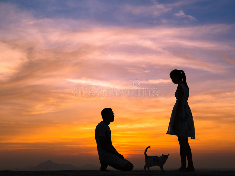 Silhouette of Couple at Sunset. Silhouette of Happy Young Couple Hugging Outside at Sunset,proposing stock images
