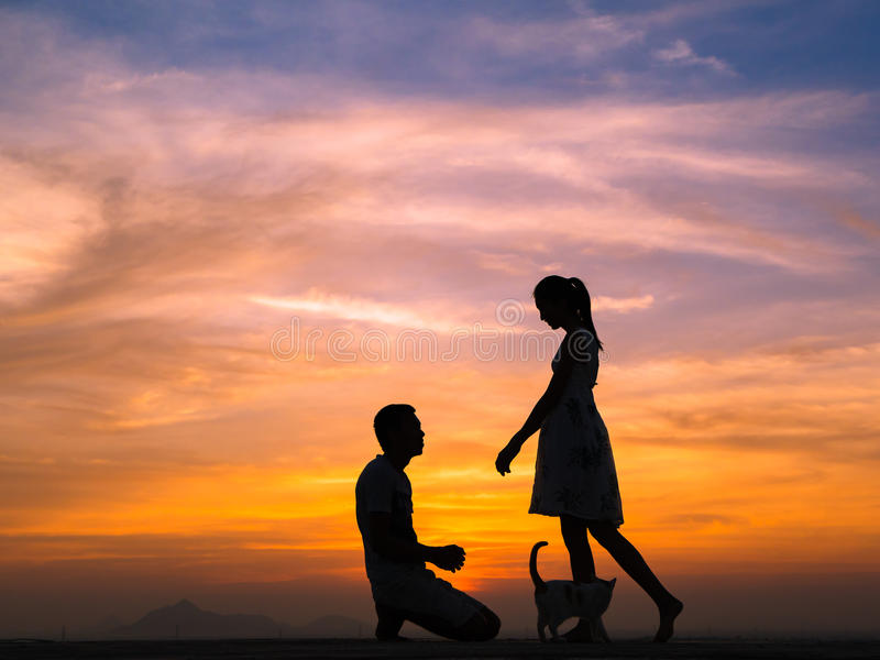 Silhouette of Couple at Sunset. Silhouette of Happy Young Couple Hugging Outside at Sunset,proposing stock photography