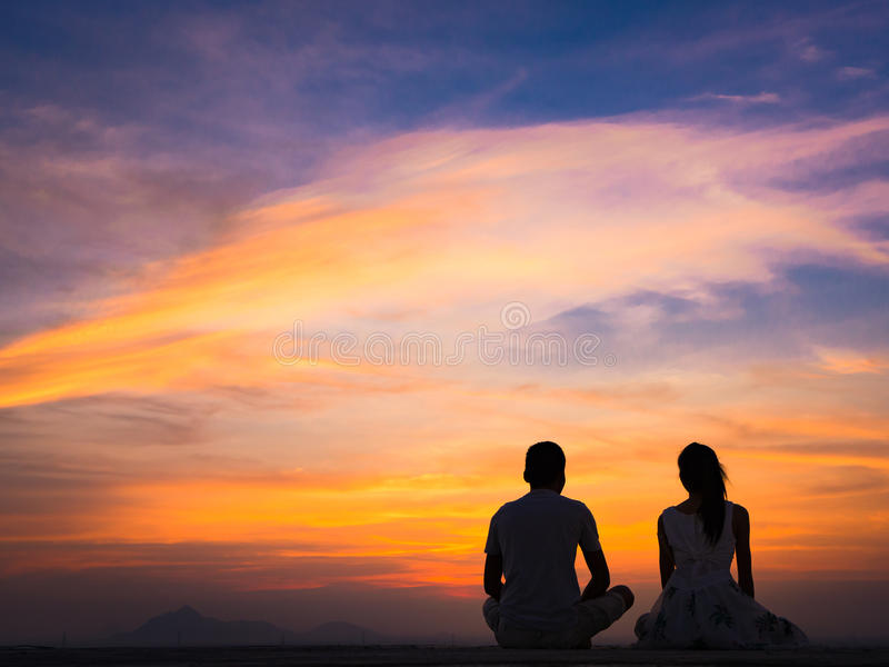 Silhouette of Couple at Sunset. Silhouette of Happy Young Couple love Outside at Sunset stock image