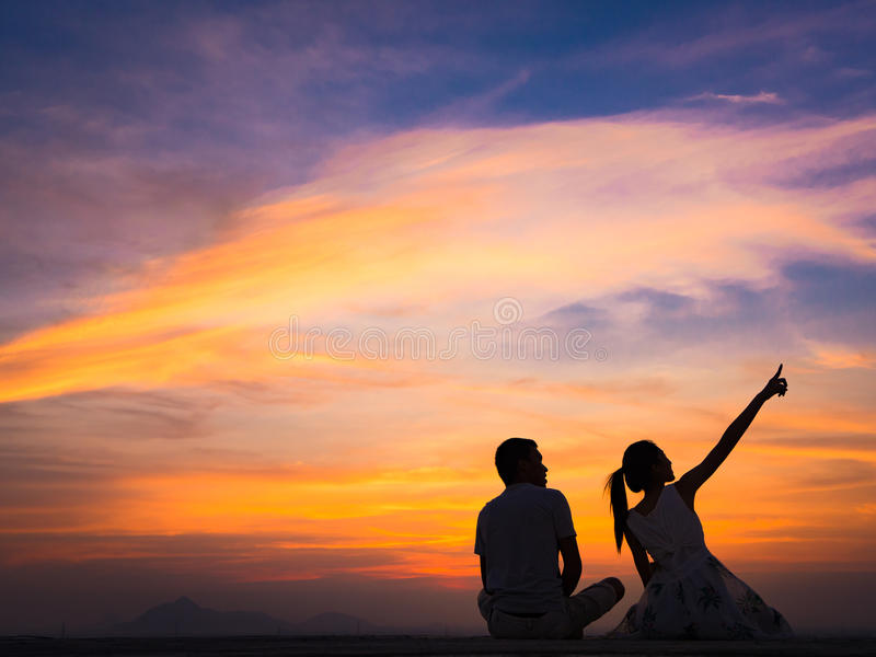 Silhouette of Couple at Sunset. Silhouette of Happy Young Couple love Outside at Sunset royalty free stock images