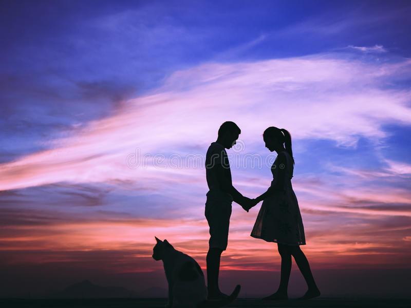 Silhouette of Couple at Sunset. Silhouette of Happy Young Couple love Outside at Sunset royalty free stock photos