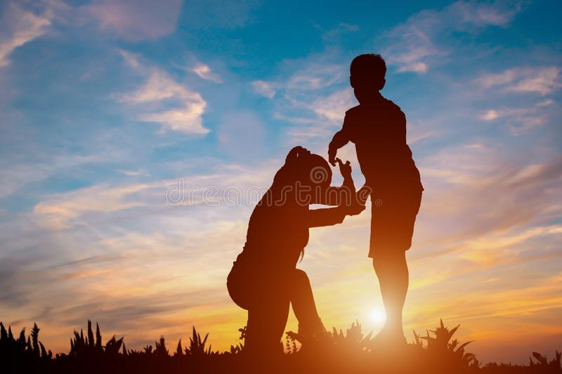 Silhouette of couple teamwork hiker helping each other on top of stock photos