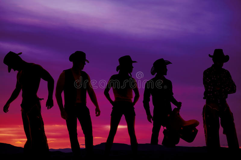 Silhouette of cowboys in sunset royalty free stock photo