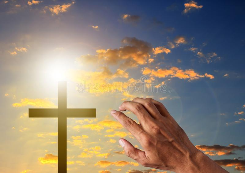 Silhouette cross in blue sky background stock photo