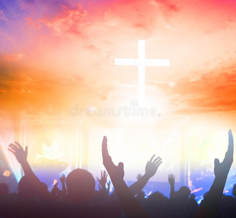 Silhouette cross on Calvary mountain sunset background. Easter concept stock images