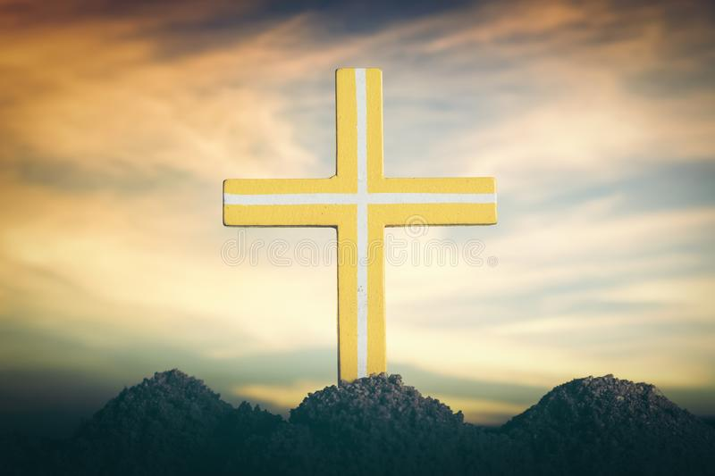 Silhouette the cross over a sunset background. stock image