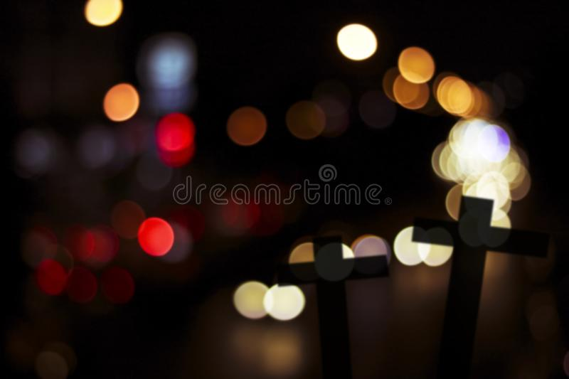 Silhouette of cross wood with bokeh background, concept as halloween, belive and spiritual. In Christian royalty free stock image