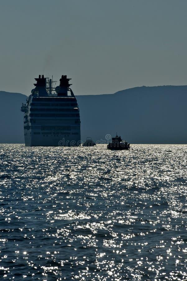 cruise ship anchored in Santorini stock photography