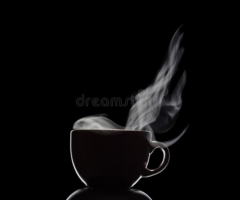 Silhouette of Cup with steam from hot drink isolated on black royalty free stock image
