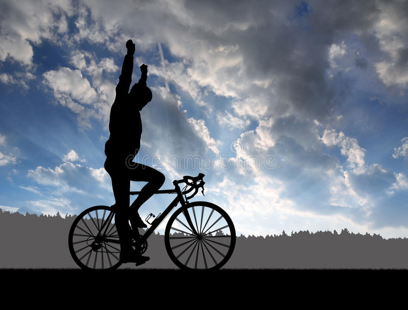 Silhouette of the cyclist riding a road bike royalty free stock photos