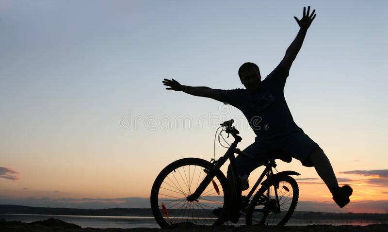 Download Silhouette Of A Cyclist At Sunset Stock Photos - Image: 24098103