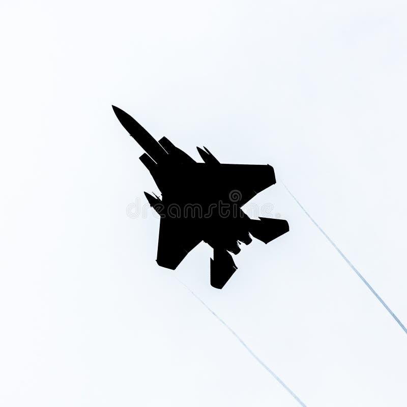 Silhouette d'avion de chasse d'Eagle de la grève F15 photographie stock libre de droits