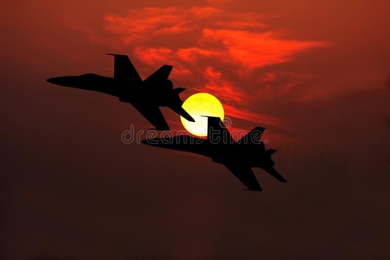 Silhouette d'avions de chasse image stock