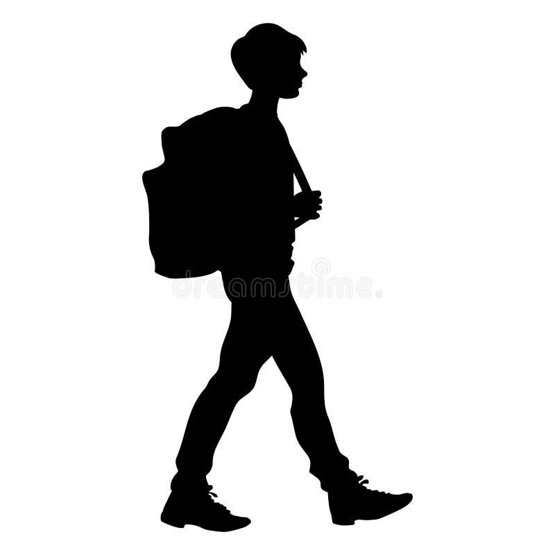 Silhouette d'isolement d'un garçon marchant avec un sac d'école photos libres de droits