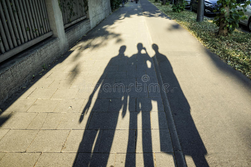 Silhouette d'ombre de famille photos stock