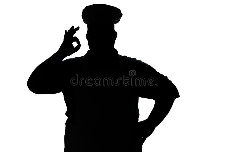Silhouette d'un chef heureux sur un fond d'isolement blanc, expositions masculines de main correctes photos stock