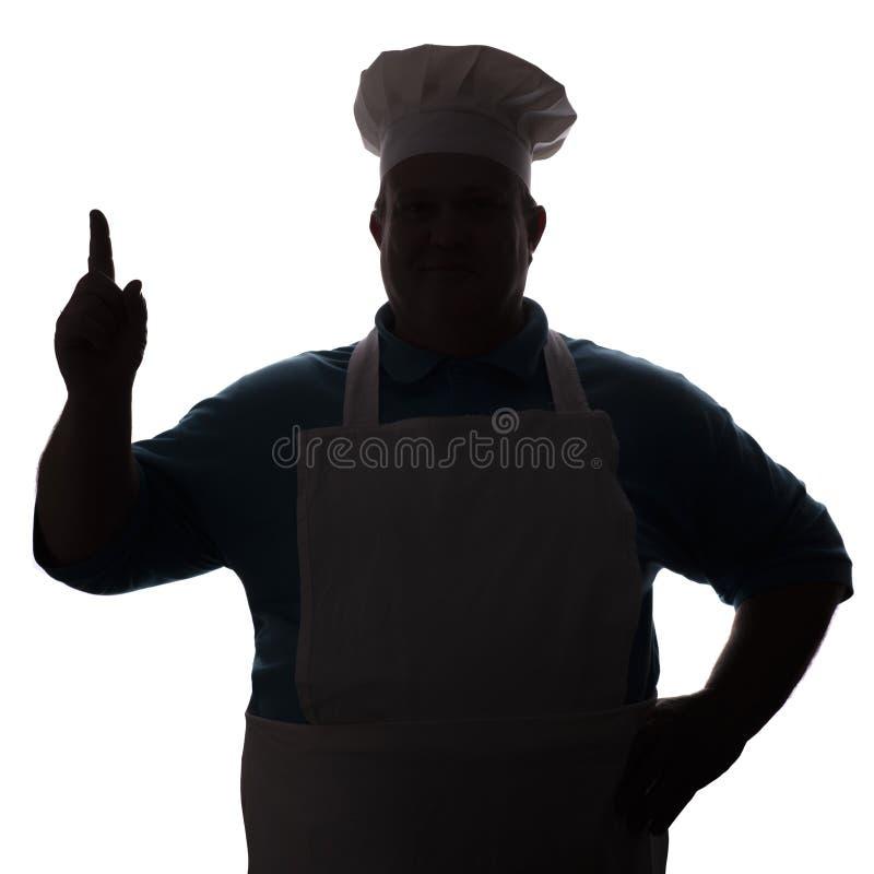 Silhouette d'un chef heureux sur un fond d'isolement blanc, main masculine apparaissant photographie stock libre de droits