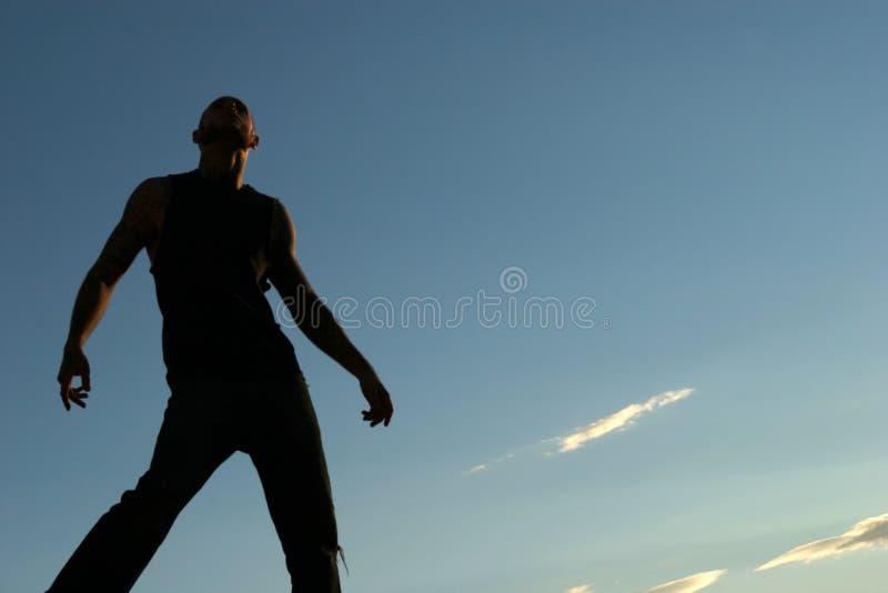 Silhouette d'un homme photographie stock