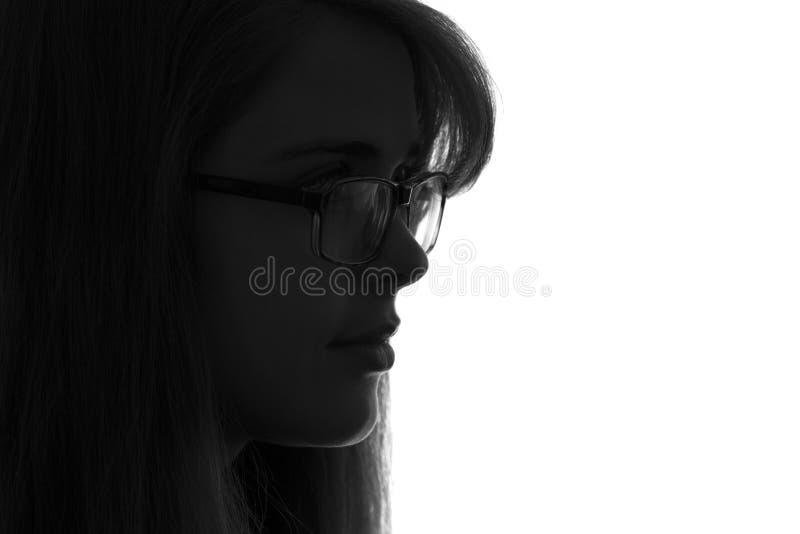 Silhouette d'une femme dans le vêtement d'affaires sur le fond photos stock