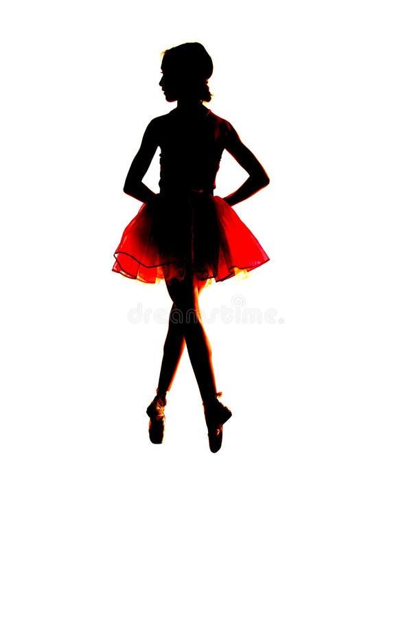 Silhouette d'une jeune ballerine flottant dans le ciel images stock