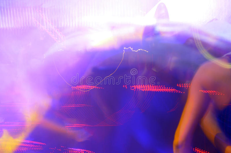 Silhouette dancing. People dancing in red and blue light stock photography
