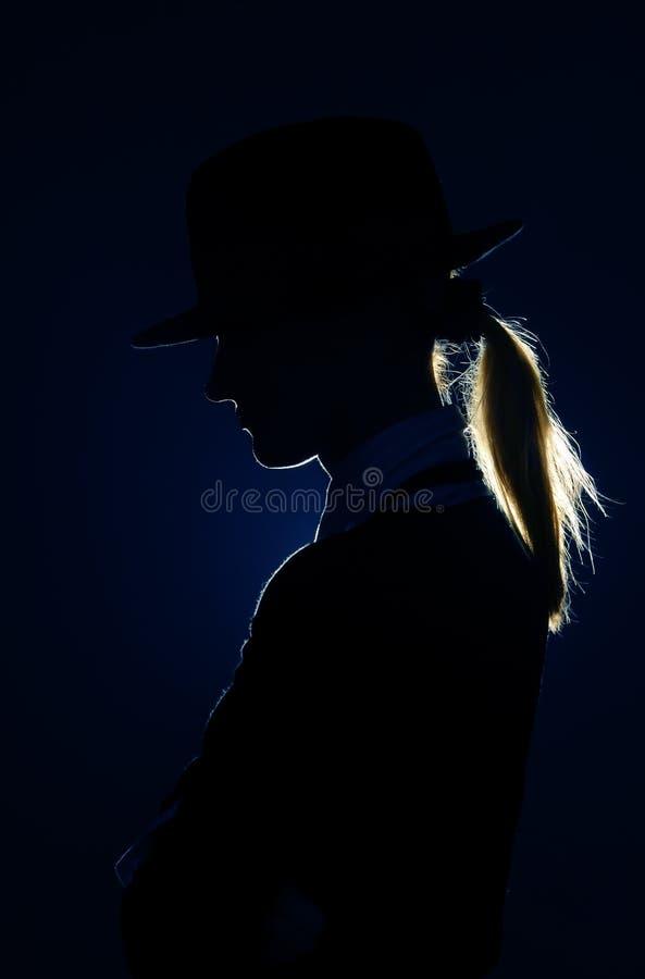 Silhouette dans le chapeau photos stock