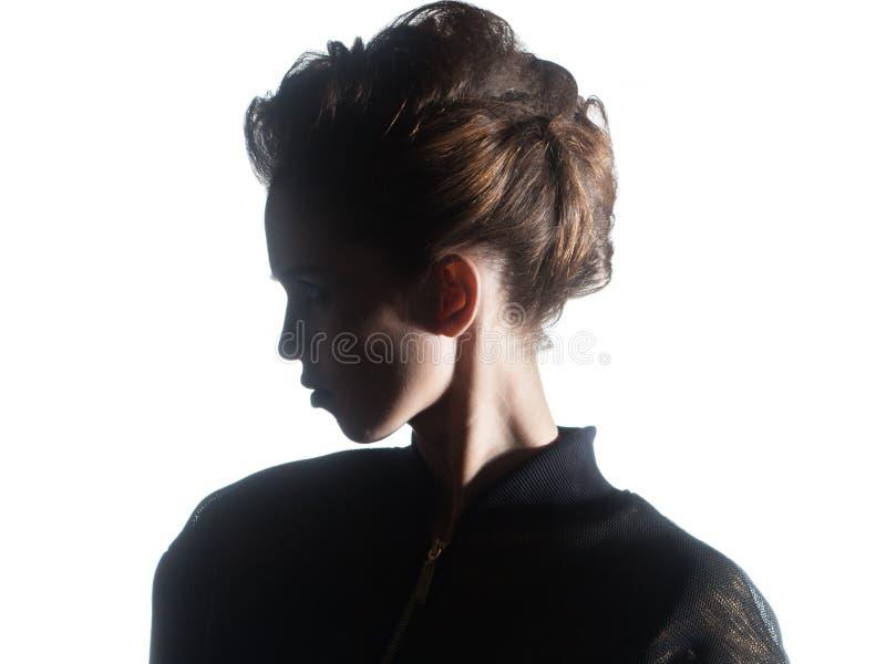 Silhouette de beau profil de femme d'isolement sur le backgrou blanc photos stock