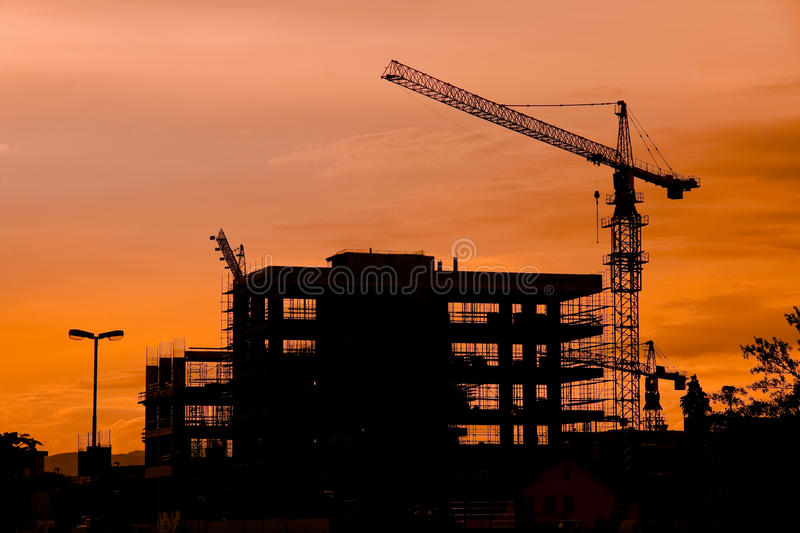 Silhouette de chantier de construction photos stock