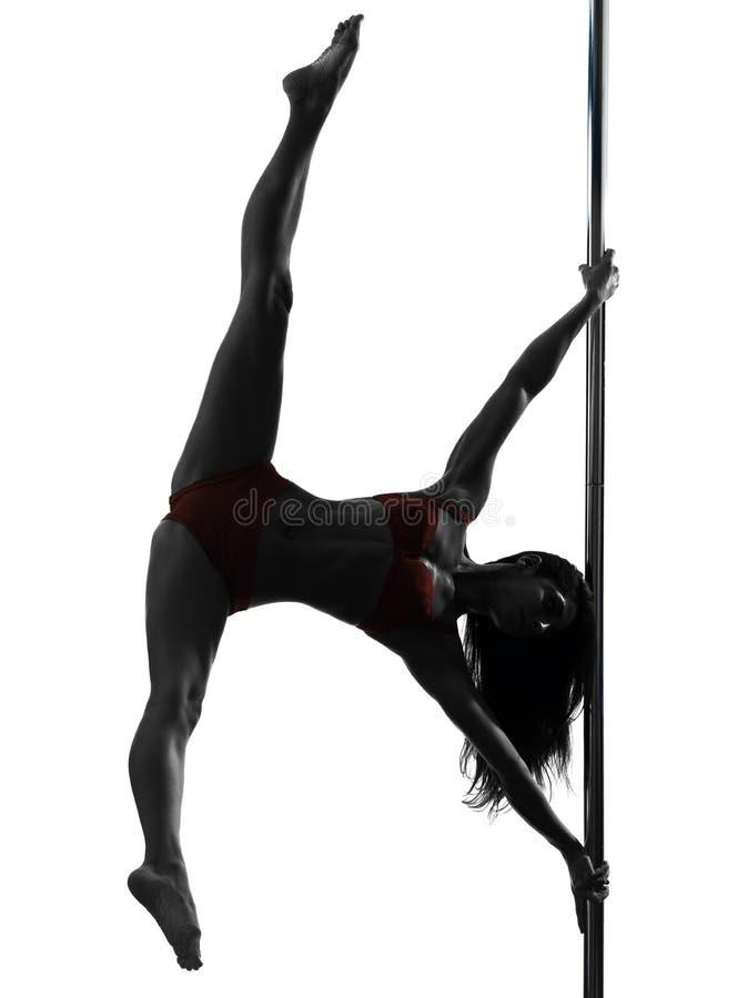 Silhouette de danseur de pôle de femme photo libre de droits