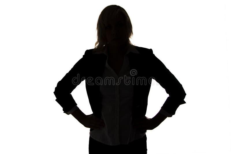 Silhouette de femme d'affaires avec des mains sur des hanches image libre de droits