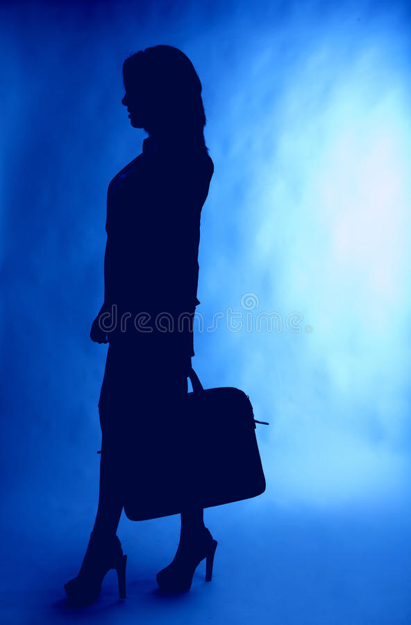 Silhouette de femme d'affaires avec la serviette image stock
