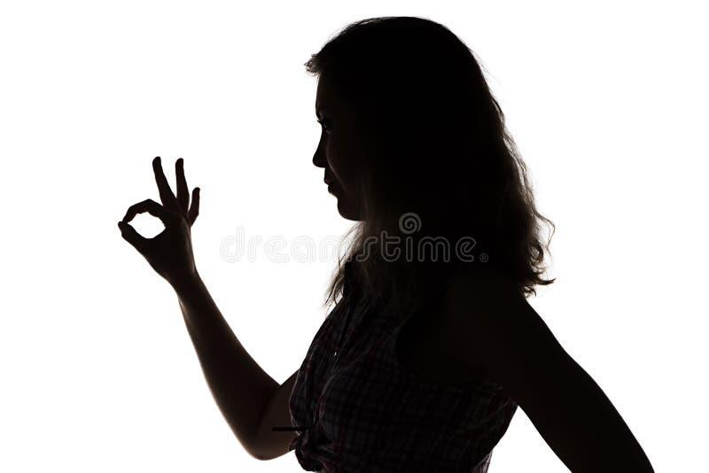 Silhouette de fille montrant correct photos libres de droits