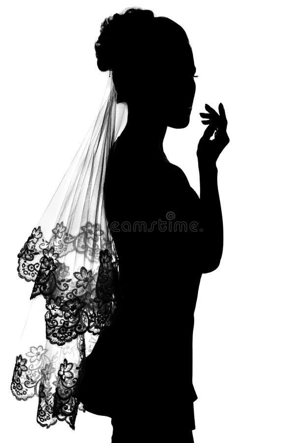 Silhouette de jeune mariée de fille. image stock