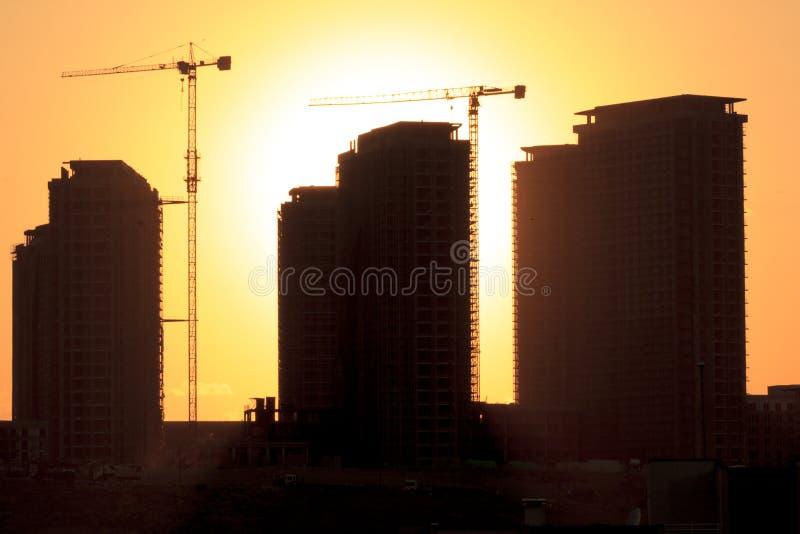 Silhouette de la construction photos stock