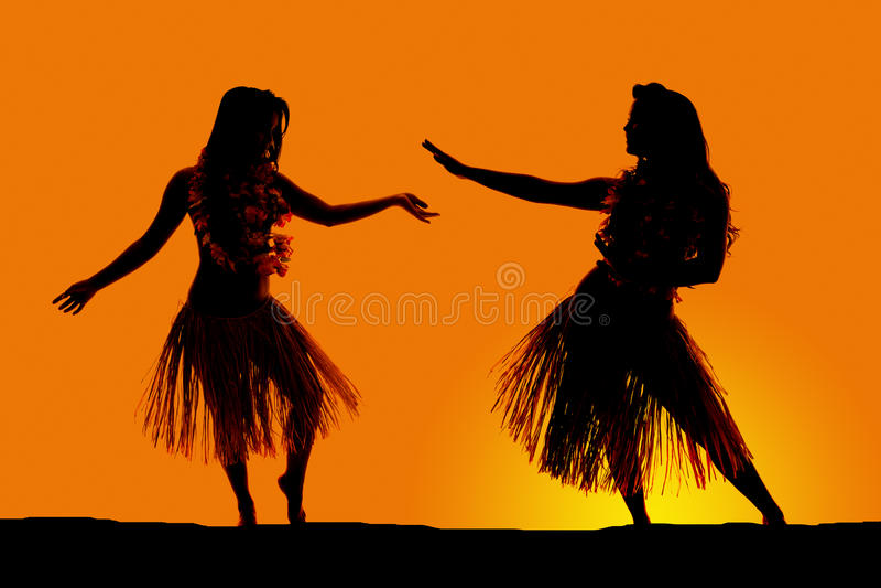 Silhouette de la danse hawaïenne de jupes d'herbe de femme photo libre de droits