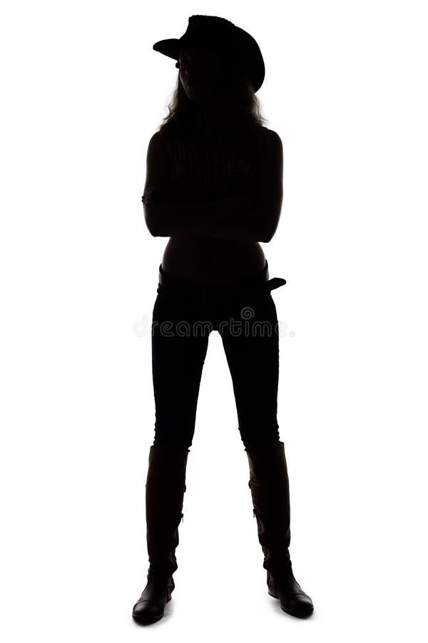 Silhouette de la jeune cow-girl - intégrale photo stock