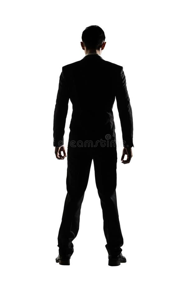 Silhouette de la position d'homme d'affaires photo libre de droits