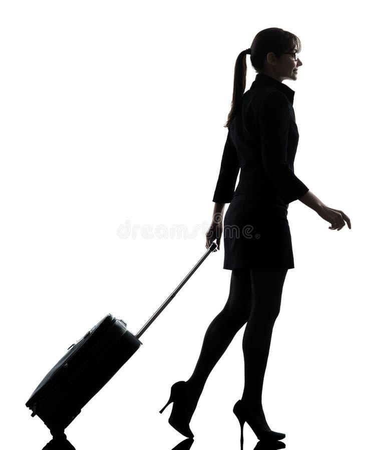 Silhouette de marche de déplacement de femme d'affaires photo stock