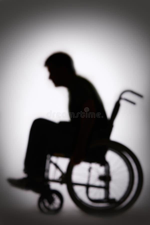 Silhouette de Person In Wheelchair handicapé image stock