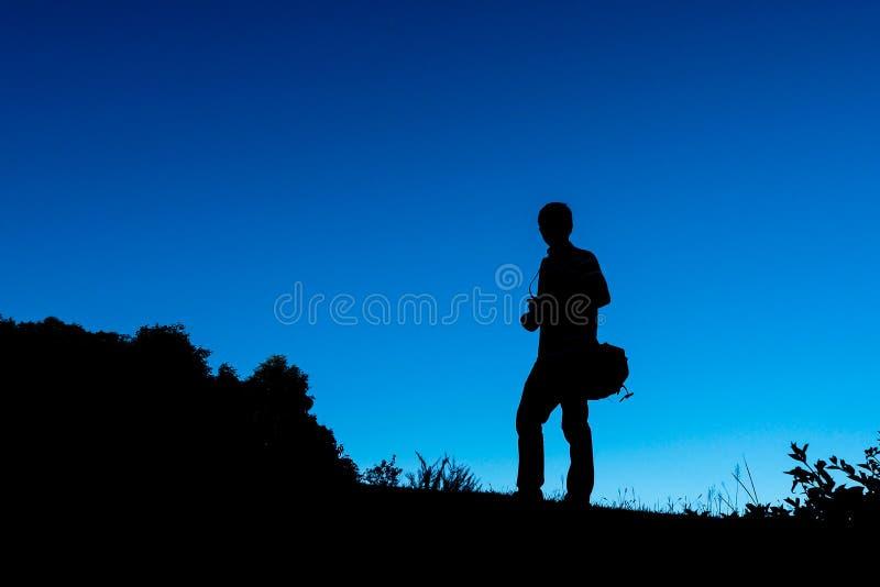 Silhouette de photoman photo libre de droits