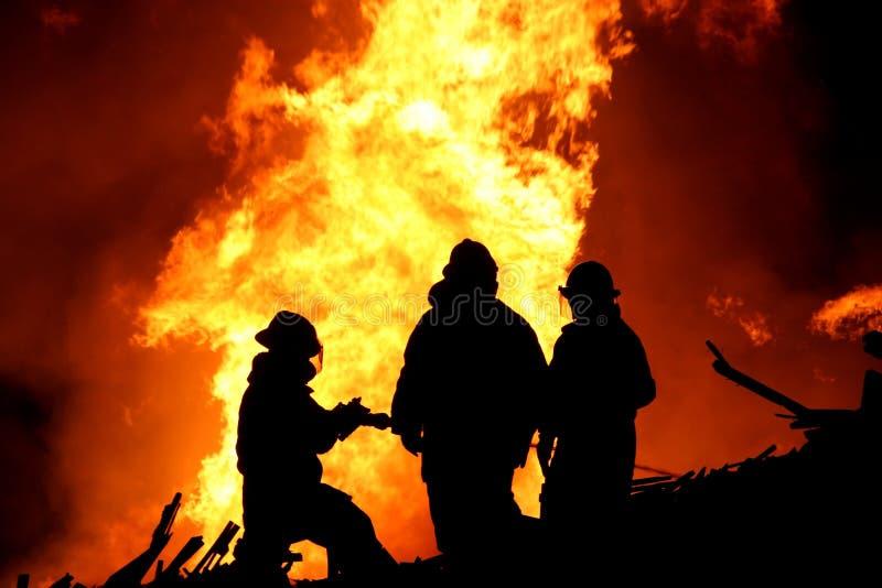 Silhouette De Pompiers Photographie stock