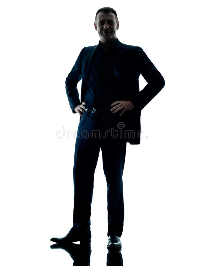Silhouette debout d'homme d'affaires d'isolement photo stock
