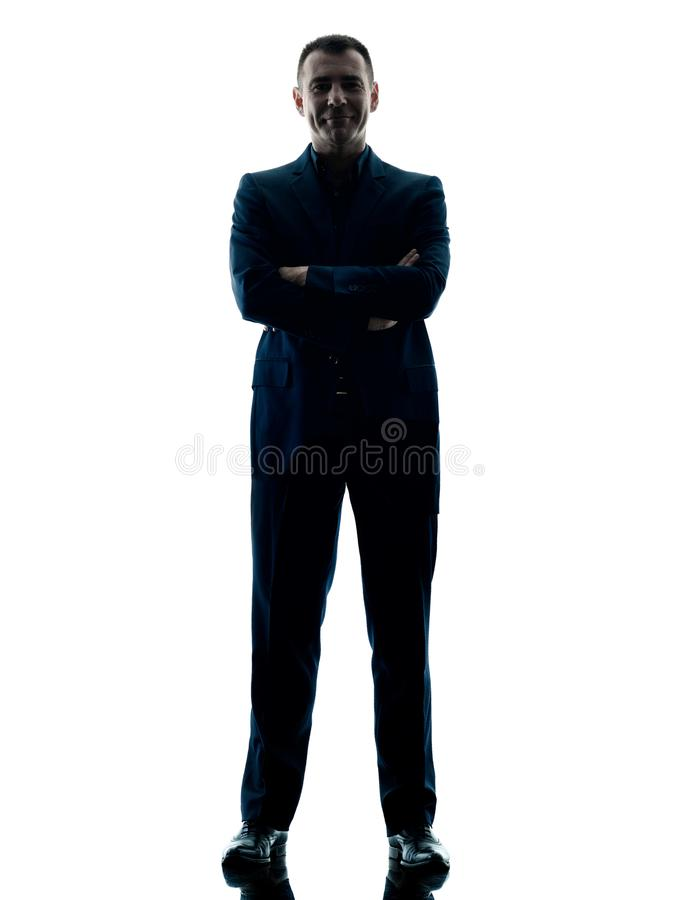 Silhouette debout d'homme d'affaires d'isolement images stock