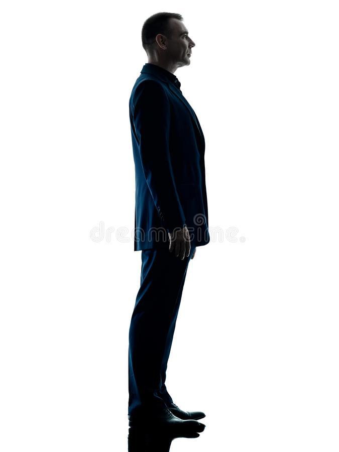 Silhouette debout d'homme d'affaires d'isolement photographie stock