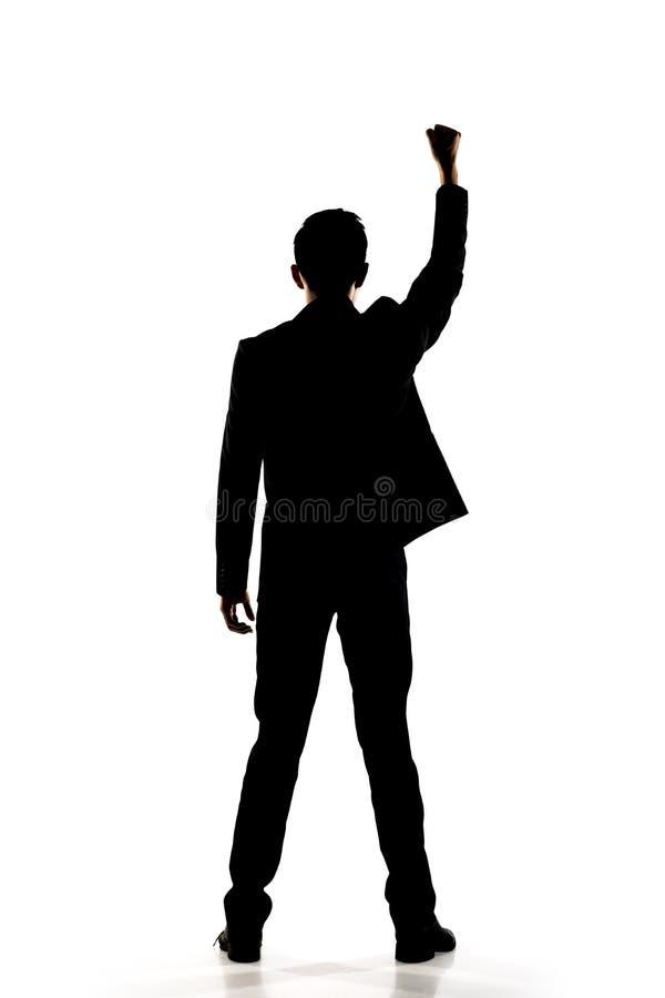 Silhouette des bras ouverts d'homme d'affaires asiatique image libre de droits