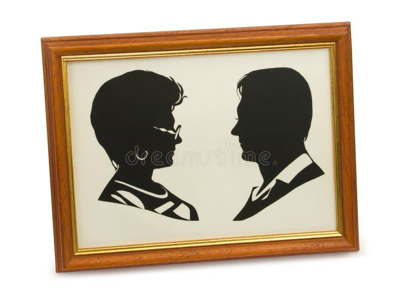 Silhouette des couples dans le cadre photographie stock libre de droits