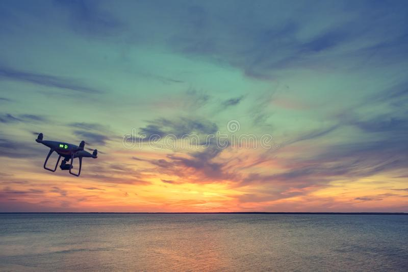 Silhouette of Drone Quad copter flying in sky royalty free stock image