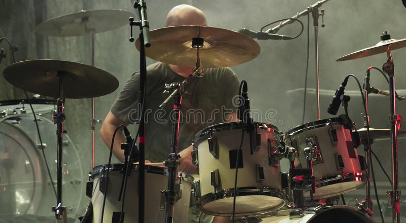 Drummer playing on drum set on stage stock photos
