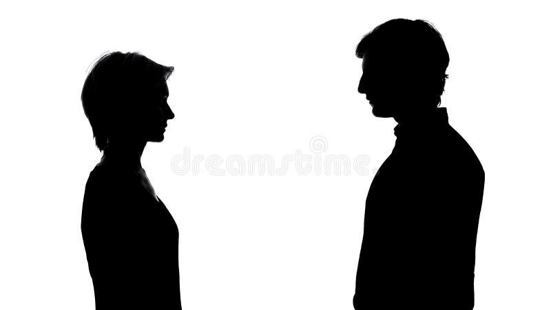 Silhouette du support de l'homme et de femme opposé, égalité des droits, publicité sociale photo stock