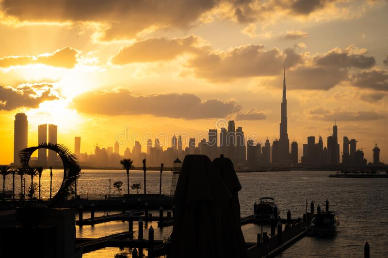 Silhouette of Dubai Skyscrapers during sunset stock images